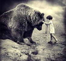 Child Touching Bear